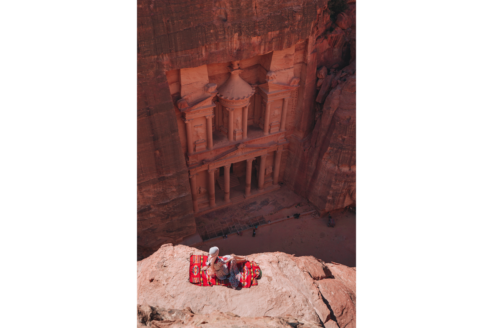 woman on ledge overlooking petra alpha 7RIII