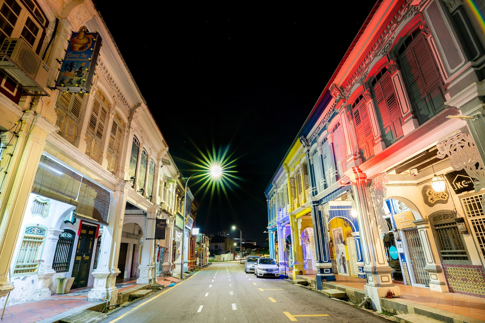 Street lined with colourful shophouses at dusk in Georgetown