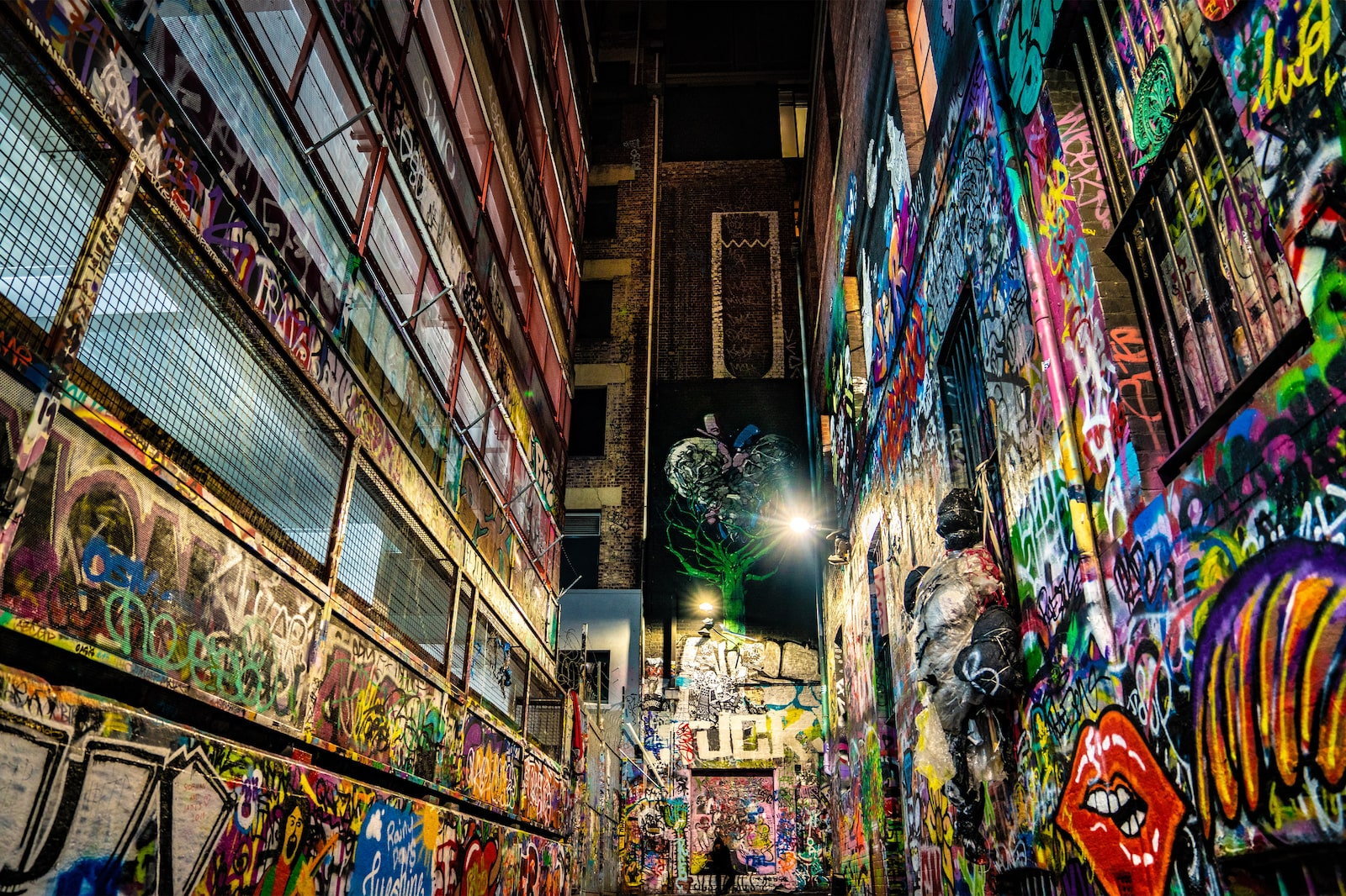 Colourful graffiti lanes facing a brick wall in Hosier Lane