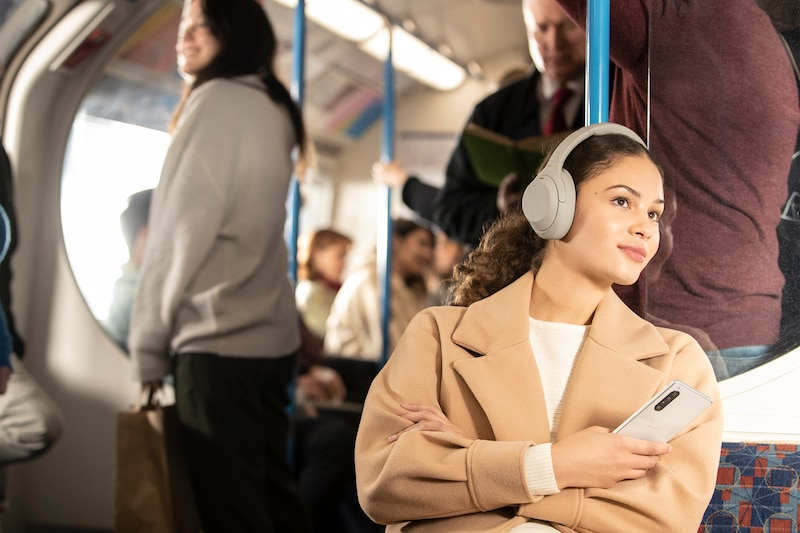 WH-1000XM4 headphones travelling on a bus