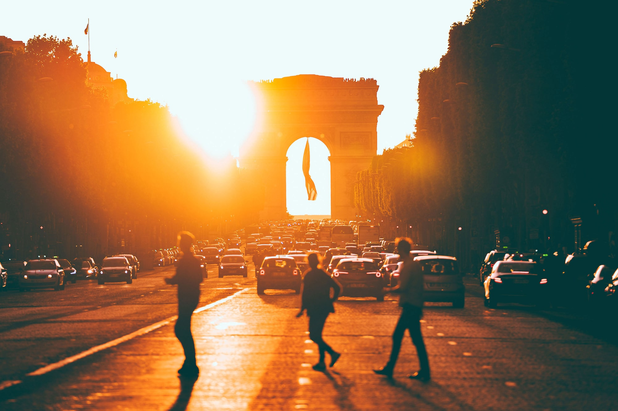 People crossing road in front of Arc de Triomphe in Paris
