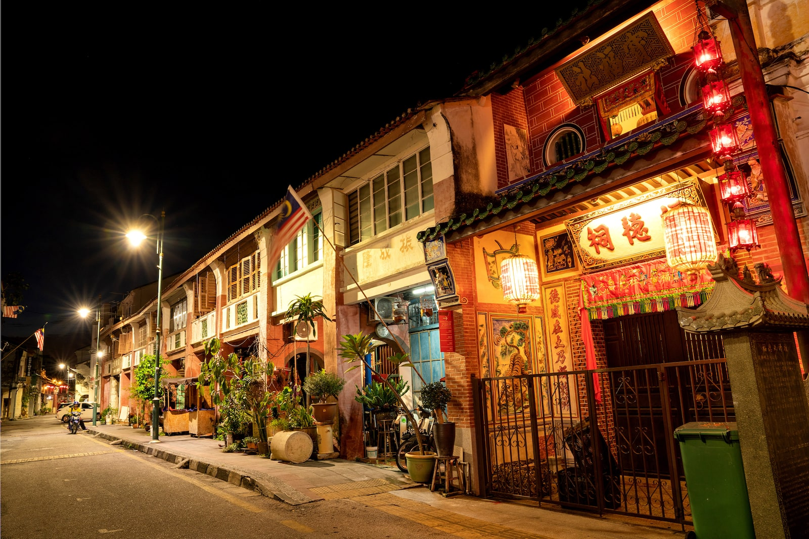 Row of traditional shophouses at dusk